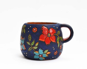 Ceramic coffee cup with magical flowers (light blue)