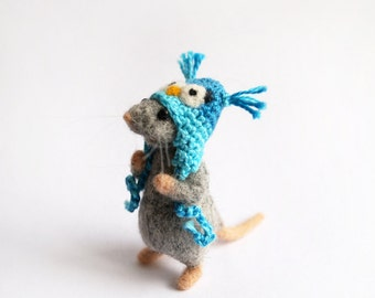 Gray needle felted mouse wearing owl hat