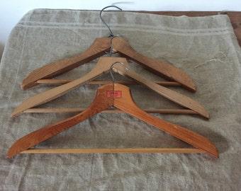 Three VINTAGE wooden clothes hangers. Vintage home / decor