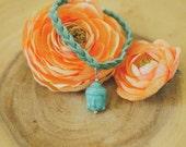 Suede Braided Bracelet w/ Buddha Head Charm