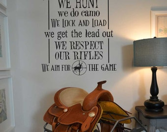 In this house we hunt we do camo we lock and load we aim for the game KW1123 vinyl wall lettering sticker