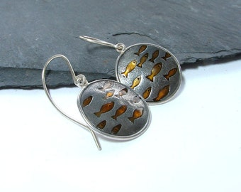 Round fish earrings in silver with orange resin inlays