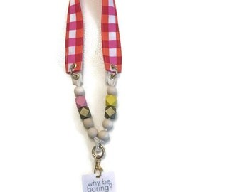 Complete Lanyard Fun bright Pink lanyard. Regular length geometric wooden beads and gold tone hardware