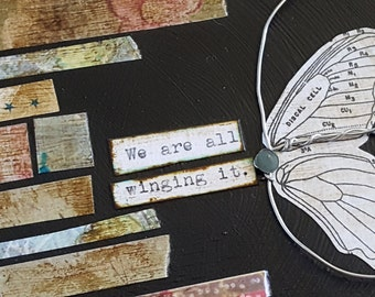 Butterfly Wing collage by Jodene Shaw on birch wood circle