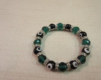 Black and emerald green evil eye beaded bracelet