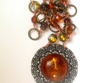 Bronze colour steampunk, vintage style necklace with amber orange color pendant, glass beads.