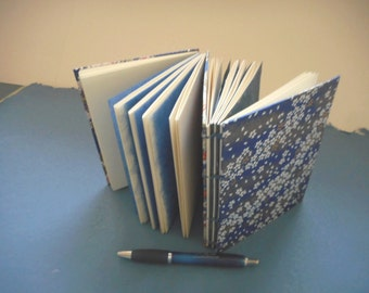 "Hand-made  dos a dos book with hand-marbled covers: ""Night Thoughts"" & ""Thoughts after Midnight"".  For writing, journal, diary, memories."