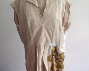 Upcycled cream coat with cat at the front and wings at the back