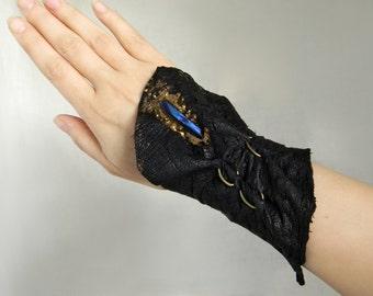 Black leather wrist cuff Tribal wide cuff bracelet with Raw crystal quartz Ostrich leather cuff Blue crystal bracelet, Bronze rings arm cuff