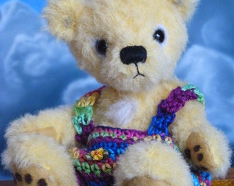 Toni, a 6,5 inches tall OOAK artist bear made from hand dyed yellow alpaca with felted paw pads