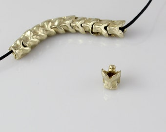 Strand of 10 Yellow Brass Small Snake Vertebrae Beads