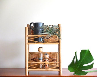 Small bamboo and wicker shelf unit / wall shelves,  1950s