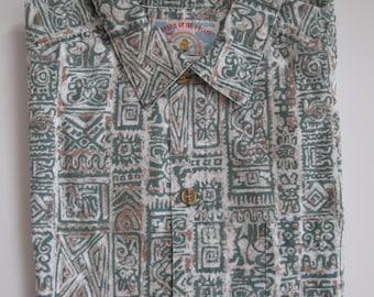 Hawaiian shirt, 1980s vintage Paradise of the Pacific green Tiki print, size large, USA
