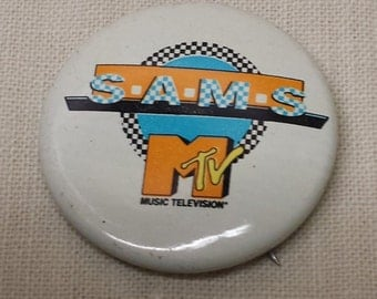 Vintage Music Television MTV SAMS Pin Back Button from the 1980s