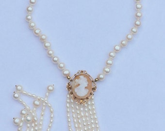 14 k antique hand knotted Pearl Necklace with hand carved shell cameo in Golden edge