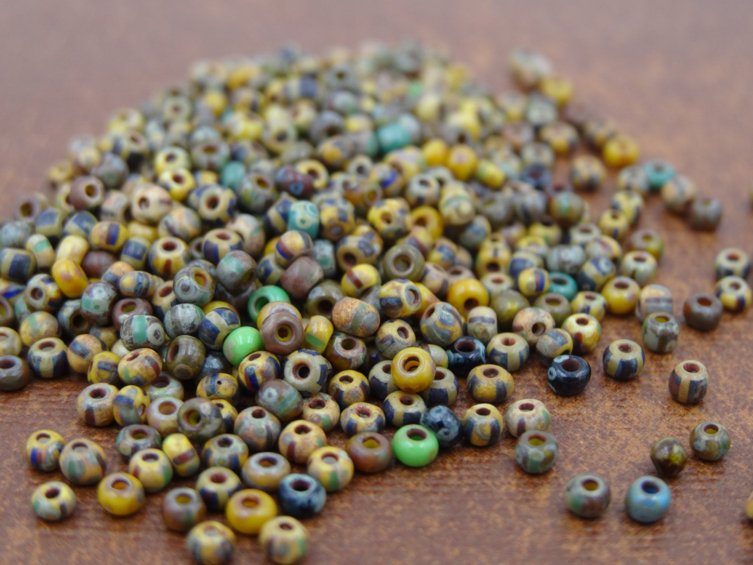 glass 10 0 aged opaque and striped picasso seed bead mix