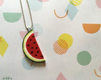 Necklace with silver wire and pendant in white colored ceramic slice of watermelon