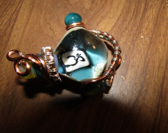 Wire wrapped blown glass OM pendant