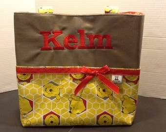 Personalized large tote bag with lots of pockets made of Winnie the Pooh fabric
