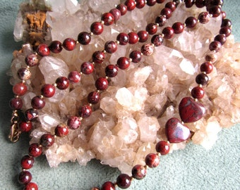 Necklace gemstone poppy jasper, 6mm rounds with 12k goldfilled accent beads, lobster clasp same metal, hand knottted, length 26 inches