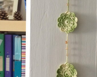 Green shades crochet pendant