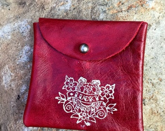red leather pouch with traditional lucky horseshoe tattoo print