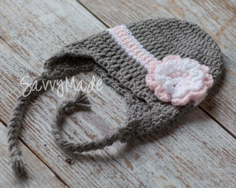 Crochet children's hat with earflaps and flower. Gray, soft pink and white. Winter hat. Girls winter hat