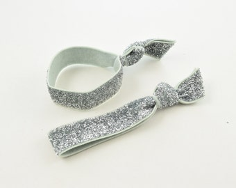 The Silver Glitter Hair Tie Set - The Package of 2 two Elastic Silver Glitter Hair Ties that Double as Bracelets by O twist