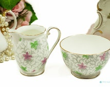 Unique Milk jug and sugar bowl by Royal Grafton 1930s. Lovely charming chintz pattern with pink and green leaves. Art Deco design