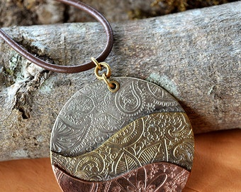 Copper, brass and nickel silver pendant