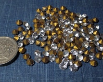 1950s vintage Glass Rhinestones: clear, various small sizes, round, faceted, foil backed -lot B-