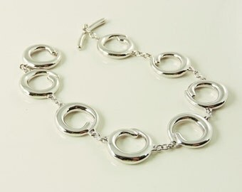 """Sterling Silver Solid Swirl Loop Toggle Bracelet With Diamond Accent 7"""""""