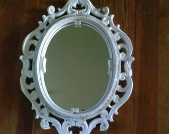 1938 Collectors Mirror. Lovely white finish with charming vintage patina.