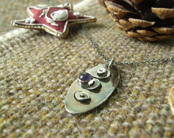 Silver Spiral/Oval Pendant with 5mm Amethyst Cabochon. Patina with Matching Silver Chain. Hallmarked.