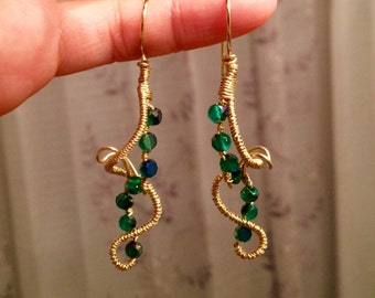 Hand wrapped gold wire earrings with crystal beads
