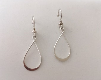 Delicate sterling silver loop dangle earrings.