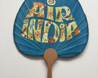 Psychedelic 1960s hand fan with Air India design.