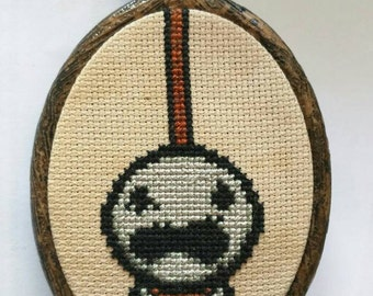 """Binding of Isaac Greed Cross Stitch in 3.5"""" Oval Hoop"""