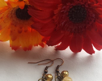 Gold bead and heart pendant earrings