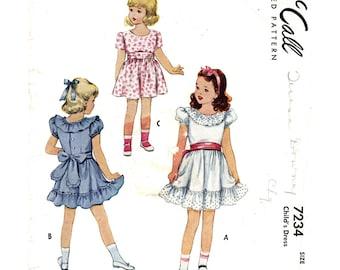 Girls 1940s Dress Pattern McCall 7234 Puff Sleeve Dress Waist Sash Neckline & Hem Ruffle Girls Sewing Pattern Size 6 Vintage Pattern