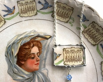Recycled china necklace. Broken china jewelry necklace antique 1916 calendar plate September 1916 bluebird