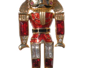 Monet Christmas Brooch Nutcracker or Toy Soldier with Red Enamel Clear Rhinestone Black Boots on Gold Tone - Vintage Figural Jewelry