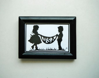 Framed Papercut USA Banner. In Black and White