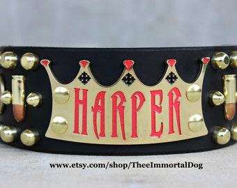 Bad Ass Diva Collar Is A 2.5'' Width Black Tapered At The Buckle Adorned With A Crown Collar Plate With Bullet & Shells And Spots.