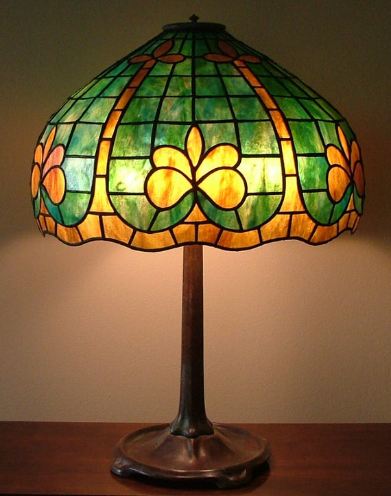 Geometric glass lamp fleur de lis shade green table like this item mozeypictures Image collections