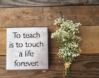 To Teach is to touch a life metal art