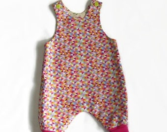 Baby girl harem dungarees/rompers approx age 3-6 months. Reversible, jazzy pink triangles, pretty birds. 100% cotton.