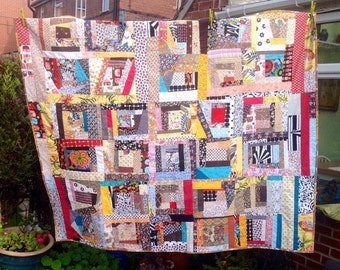 REDUCED Crazy Patchwork scrap Quilt. Vintage fabric.  Free motion quilted. Throw or single bed