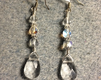 Clear Czech glass briolette dangle earrings adorned with clear Czech glass beads.