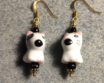 Black and white ceramic Spuds Mackenzie puppy dog dangle earrings adorned with black Czech glass beads.